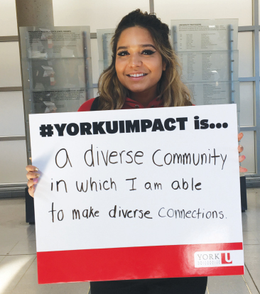 YorkU student holding sign about diversity